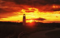 Highland Lighthouse Sunset Cape Cod. The Highland Lighthouse against a beautiful sunset in North Truro Massachusetts on the Cape Cod National Seashore royalty free stock photography