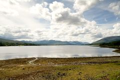 Highland Loch. A highland landscape with dramatic clouds royalty free stock photo