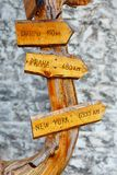 Highland mountain wooden signs showing distance and direction to some significant cities. Stock Photo