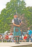 Highland piper at Strathpeffer. Stock Photography