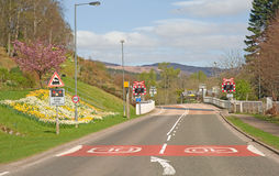 Highland road and railway crossing. Stock Photography