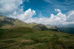 Highland, Sky, Grassland, Mountainous Landforms royalty free stock image