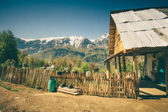 Highland village traditional wooden house and fence Royalty Free Stock Photography