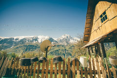Highland village traditional wooden house and fence Royalty Free Stock Photo