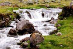 Highland waterfall 1. Highland waterfall and some rocks Stock Image