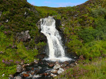 Highland Waterfall. Waterfall in the middle of nowhere in the highlands of Scotland with heather and bracken growing lusciously around Royalty Free Stock Photography