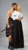 Highlander. Couple posing in historical highland clothing Stock Photos