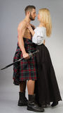 Highlander. Couple posing in historical highland clothing Stock Images