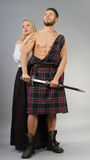Highlander. Couple posing in historical highland clothing Royalty Free Stock Photo