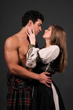 Highlander Romance. Couple posing in medieval highlander outfits Stock Images