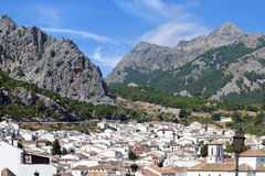 In the highlands Mountains. Aerial view of Grazalema is located in the Spanish province of Cadiz, a typical rural village of white houses with mountains in the Stock Images