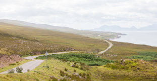 Highlands of Scotland narrow road in mountain landscape Royalty Free Stock Photos