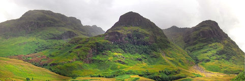 Highlands valley of scotland with mountains. Highlands valley of scotland with green mountains Royalty Free Stock Photography