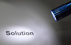 Highlight solution. The word Solution highlighted by a torch lamp Royalty Free Stock Image