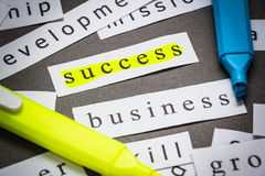 Highlight success. Success word on piece of paper with highlight pen royalty free stock image