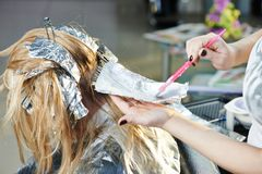 Highlight. woman hairdressing in salon Stock Photo