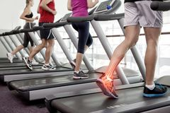 Highlighted ankle of man on treadmill Royalty Free Stock Image