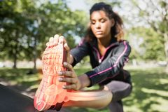 Highlighted ankle of stretching woman Royalty Free Stock Photos