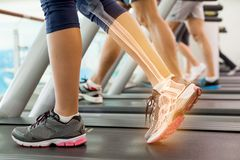 Highlighted ankle of woman on treadmill Stock Photos