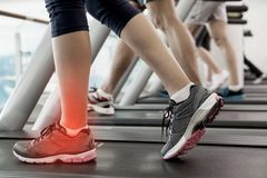 Highlighted ankle of woman on treadmill Royalty Free Stock Photos