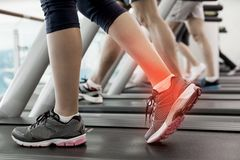 Highlighted ankle of woman on treadmill Stock Photography