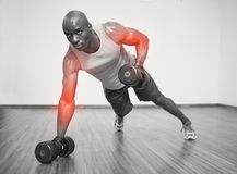 Highlighted arm of strong man lifting weights Royalty Free Stock Image
