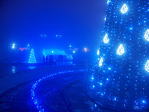 Highlighted artificial Christmas tree Stock Photography