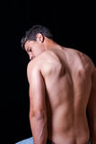 Highlighted back of male posing topless Royalty Free Stock Image