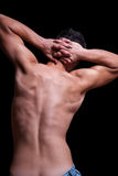 Highlighted back of male posing topless Royalty Free Stock Photography