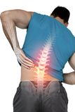 Highlighted back pain of fit man Royalty Free Stock Photo
