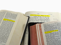 Highlighted Bible passage. Isaiah 55:6 highlighted in English (KJV), German, and Hebrew Bibles, with clipping path stock photo