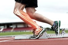 Highlighted bones of man about to race. Digital composite of Highlighted knee of man about to race Stock Photography