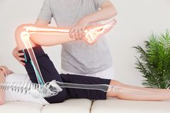 Highlighted Bones Of Woman At Physiotherapist Royalty Free Stock Photo