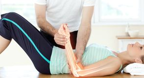 Highlighted Bones Of Woman At Physiotherapist Royalty Free Stock Images