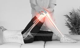 Highlighted bones of woman at physiotherapist Stock Images