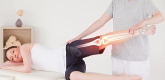 Highlighted bones of woman at physiotherapist Stock Image