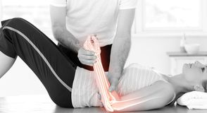 Highlighted bones of woman at physiotherapist Royalty Free Stock Photography