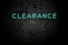 Free Highlighted Brick Wall With Neon Inscription Clearance Stock Photography - 158970682