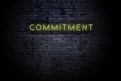 Free Highlighted Brick Wall With Neon Inscription Commitment Royalty Free Stock Images - 158584079