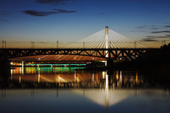 Highlighted bridge at night and reflected in the water Royalty Free Stock Photography