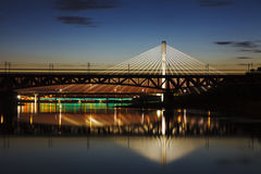 Highlighted bridge at night and reflected in the water Royalty Free Stock Photos