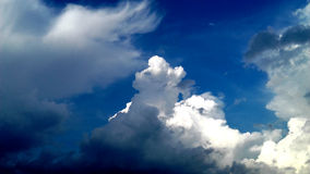 Highlighted Clouds. Clouds on the blue sky Royalty Free Stock Photo