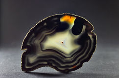 The highlighted Cut of white agate. The highlighted Cut of black agate on a dark background stock images
