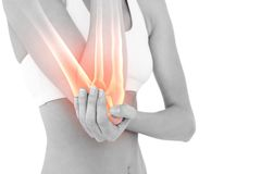 Highlighted elbow pain of woman Stock Image