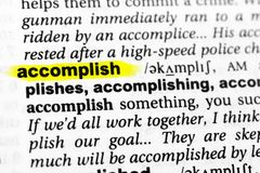 Highlighted English word `accomplish` and its definition in the dictionary.  stock image