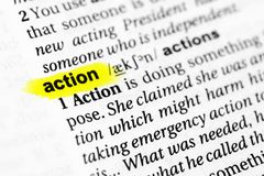 Highlighted English word `action` and its definition in the dictionary.  Royalty Free Stock Photo