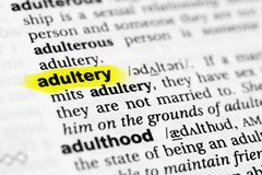 Highlighted English word `adultery` and its definition in the dictionary.  Royalty Free Stock Photo