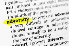 Highlighted English word `adversity` and its definition in the dictionary.  royalty free stock photography