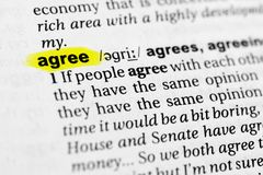 Highlighted English word `agree` and its definition in the dictionary.  Royalty Free Stock Photos