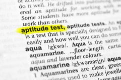 Highlighted English word `aptitude test` and its definition in the dictionary.  Royalty Free Stock Image